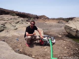 2014_Nick pumping drinking water
