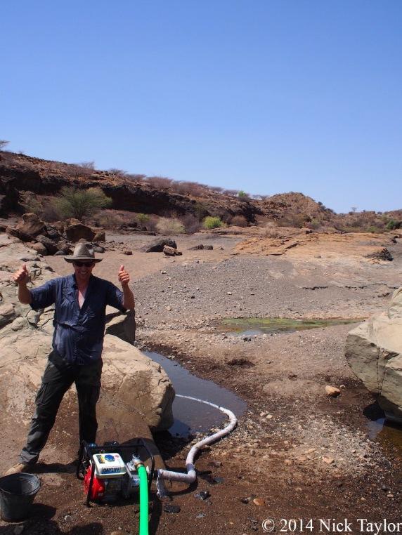 2014_Xavier celebrates water pumping