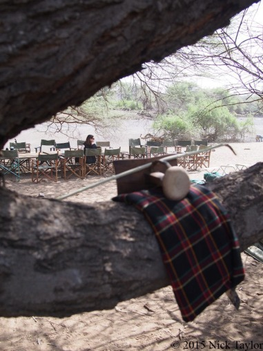 2015_Sonia at the camp table with Turkana seat, stick and wrap in the foreground