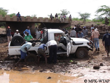 helping others to cross the river on the way to Turkana