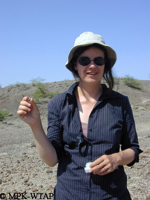 Sandrine holding a new fossil find
