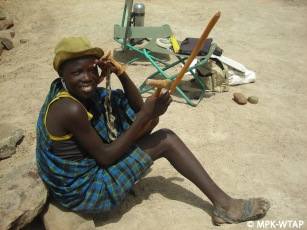 A young Turkana goatherder watches the excavation of Nasura 1