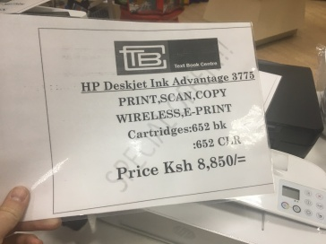 Printed information sign alongside printers for sale in Nairobi