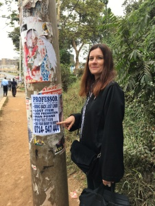 Professor Sonia Harmand with a typical Nairobi 'psychic' poster