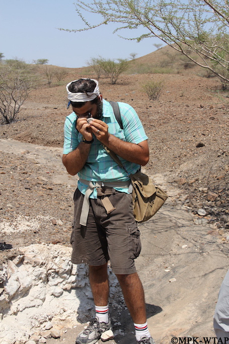 2012_Geologist Chris Lepre examining samples