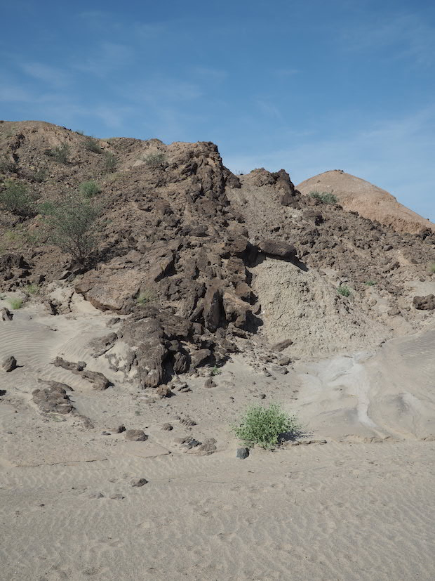Geological fault (centre) separating sediments to left and right