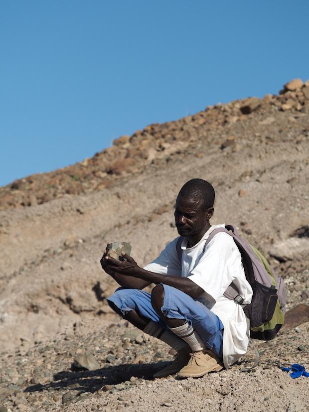 Sammy Lokorodi inspecting a potential artefact