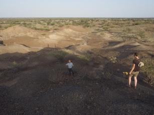 Students Evan Wilson and Jenna Anderson surveying near Lomekwi 3