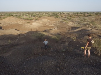 Students Evan Wilson and Jenna Anderson surveying near Lomekwi 3