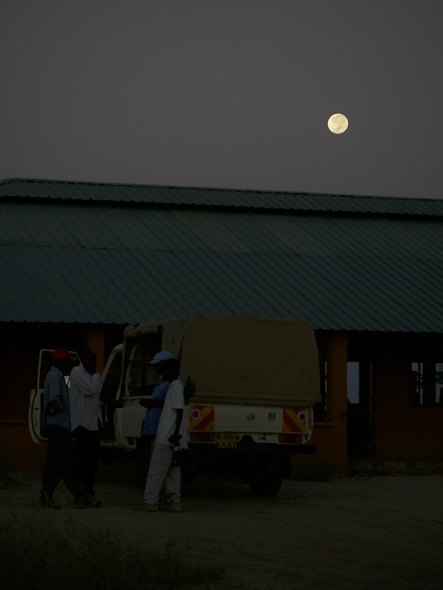The team unpack the vehicle at the end of the day, with a 'Supermoon' hanging overhead