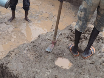 A rainstorm brings problems for one of our excavation trenches