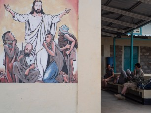 A mural at the Nariokotome dispensary as WTAP members wait for results