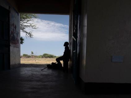 A Turkana woman waits at the Nariokotome dispensary